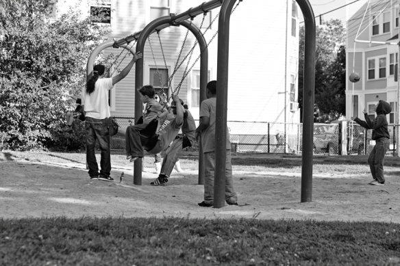 Parents and their children at the swings.