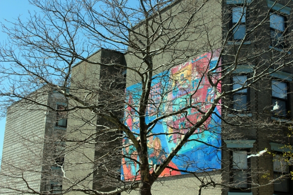 Harbor Street mural through trees
