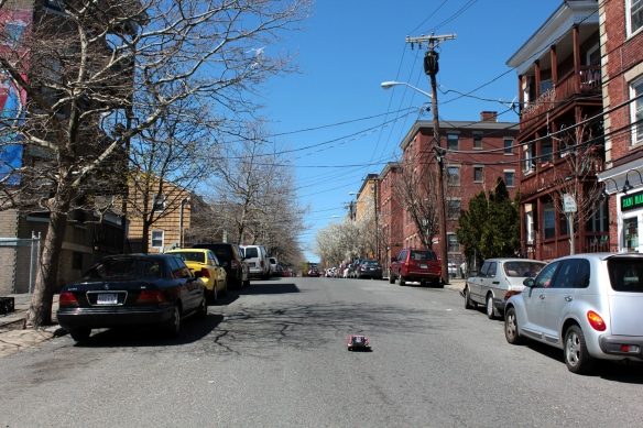 Toy car speeds down Harbor Street